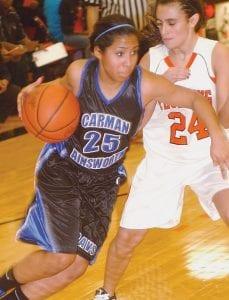 Carman-Ainsworth's Jasmine Jones drove hard to the basket.