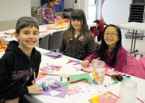 Trevor Cook, 7, from left, Tiffany Cook, 9, and Breanna McChristion, 8, made Valentine's and ate cupcakes.