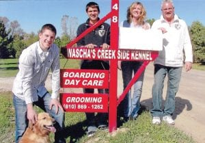 The Wascha Family: Lily, the family dog, Aaron, Jordan, Molly and Tim outside Wascha's Creekside Kennel.