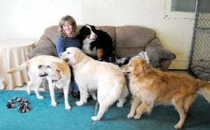 Molly Wascha, owner of Wascha's Creekside Kennel, poses with some of her fourlegged 'customers.'