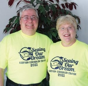 "Patty and Terry Horvath sporting their bright green volunteer T-shirts they had made for their ""Seaing Our Dream"" cruise where they helped book and plan a cruise for 51 visually impaired individuals."