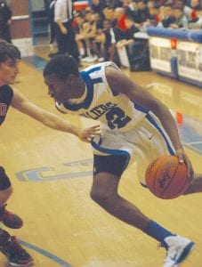 Anton Wilson led the Carman-Ainsworth boys' basketball team to a 52-38 district-opener win.