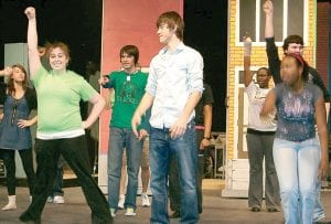 "The cast of the Carman-Ainsworth High School production of the musical ""Hairspray"" perform during rehearsals recently."