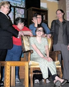 Mariah Paris, seated, and Alberta Dillard (from left), Jeanne Beville, Kathy Russell and Patty Paris rehearse a scene.