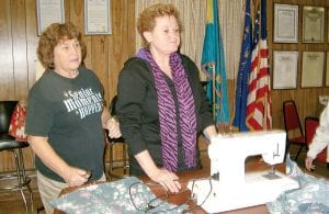 President Jolene Ballard, right, and an auxiliary member at the sewing machine.