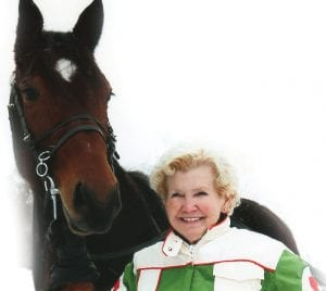Yvonne Sova with the horse from Mike Sweeney's harness racing farm in Davison.