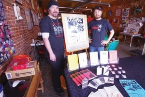 Charles Shaver and Chris Reed display some of the work that will be available at the Atomic Swan Zine Fest, April 8 from 6-9 p.m. at the Lunch Studio, 444 S. Saginaw St., Flint.