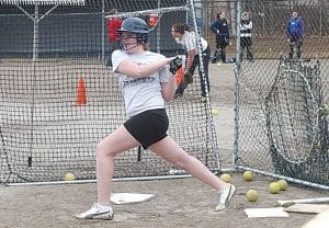 Carman-Ainsworth's Jessica McClung in batting practice last week.