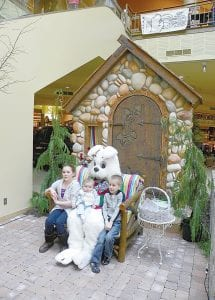 EASTER BUNNY — The Easter Bunny arrived at Genesee Valley Center last weekend. pictured with the bunny are Emma Boychuk, 10, Caden Boychuk, 5 and Grayson Boychuk, 6 months, all of Burton.