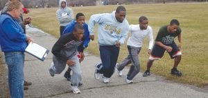 Carman-Ainsworth boys' coach Kenn Domerese put his runners through time trials.