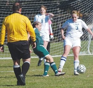 Carman's Toni Jarnigin (#3) looks to clear the ball at home against Lapeer East on Tuesday.