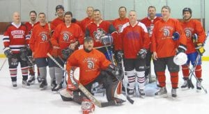 Caption: Pictured l-r off the Carman-Ainsworth team are: (front) goalie Brad Kippe ('86 Ainsworth), (Left to Right) Chad Borg ('91 Carman-Ainsworth), John Whitten ('88 Carman- Ainsworth), Chuck Raske ('83 Ainsworth), Scott McNiel ('86 Ainsworth), Rod Kippe ('82 Ainsworth), Rob Chatters ('83 Ainsworth), Mark Whitten ('82 Ainsworth), Mike Boyd ('82 Ainsworth), Dave Barbour ('83 Carman), John Schied (Ainsworth Coach 84-86), Jeff Kippe ('82 Ainsworth), Dan Whitten ('86 Ainsworth) Not Pictured: Jeff Whitten ('89 Carman-Ainsworth).