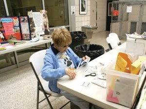 Jeanne Aaronson clips a VG's receipt as part of her volunteer work at The Human Society of Genesee County.