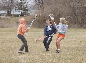 The Lady Cavaliers varsity girls lacrosse team, pictured here during a practice session earlier this season, was out of rotation this week because of the low temperatures and high winds but got back in the swing of things yesterday at Swartz Creek.