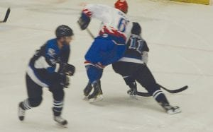 Warriors forward Ryan Green battles for the puck after a face-off during Friday's game three
