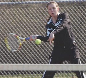 Carman-Ainsworth's Taylor Kost got behind a back-hand return.