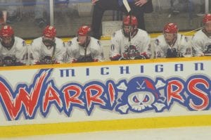 The Michigan Warriors gathered on the bench during a timeout.