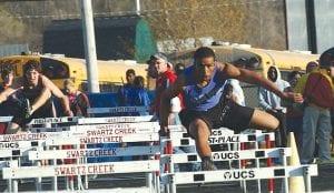 Carman-Ainsworth's James Madison jumps the hurdles.