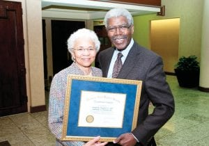 Samuel R. Dismond, Jr., MD, Hurley Family Physician, and his wife, Janice A. Dismond, RN, with their award from the MSMS.