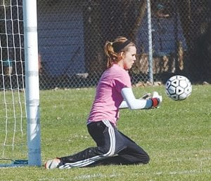 Carman-Ainsworth goalie Savannah Lacey made a save in net during a recent game.