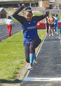 Carman-Ainsworth's Ashley Hall soars in the long jump.