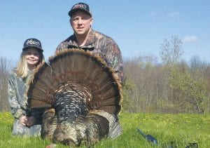 Todd Collick and his daugher, Hannah, displayed his possible new state record tom.