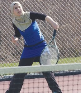 Carman-Ainsworth's Mariam Salman returns the volley at the No. 2 singles position.