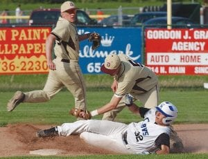 Carman-Ainsworth's Justin Hubbard (#32) slides in under the tag against Davison.