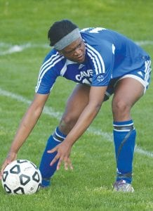 Carman-Ainsworth's Aiana Jamison scoops the ball.
