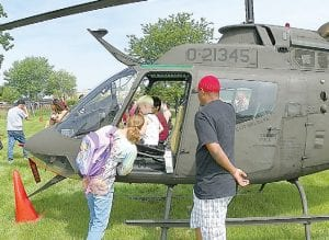 Kids lined up for a chance to sit in this Army helipcoper flown in from Grand Ledge for the 15th annual Transportation Day event.