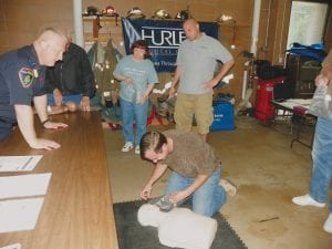 Mike Watchowski of Flushing practices chest compressions supervised by Brett Beckley, STAT EMS paramedic