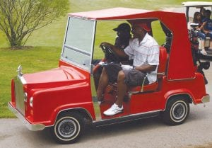 Carman-Ainsworth grad Brandon Carr will return for his 3rd annual golf outing to help fund the football program. Carr is shown here in his custom golf cart at last year's outing.