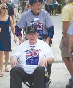 Elmer Leach of Davison visiting the memorial, pushed along in his wheelchair by guardian William Goodfellow of Davison.