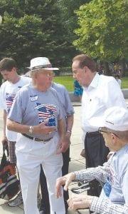 Veteran Arthur Holst talks with former Sen. Bob Dole at the World War II Memorial in Washington, D.C.