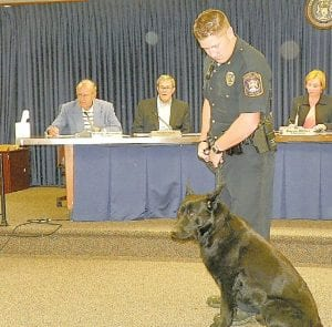 — Gunner, the newest member of the Flint Township Police Department, was introduced to the township board at its Monday night meeting. Gunner is a 27- month old German Shepherd imported from Holland, said Police Chief George Sippert, who introduced the dog and his handler Officer Neal Donovan. Donovan and Gunner recently completed five-weeks of training at the Oakland Police Academy in Auburn Hills.