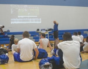 A thunderstorm Monday forced the Cavs inside the gym, but coach Nate Williams used the time for film study.