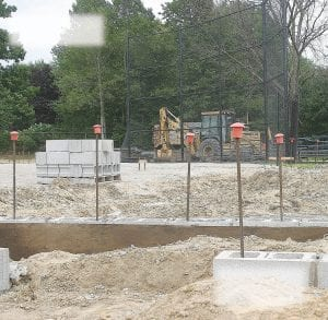 The old dugouts are gone, and construction has begun on new ones at the Carman- Ainsworth varsity softball field. They will be ready in plenty of time for next season.