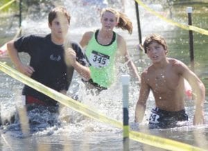 Matthew Kettelwell of Croswell and Hannah Tubbs of Sandusky worked their way through the Dare Devil Dash in Brown City last Saturday.