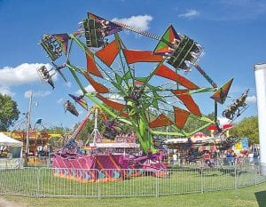 Carnival rides at the Genesee County Fair (left) from a previous year. Below, horses are part of 4-H events and displays at the 2011 Genesee County Fair.