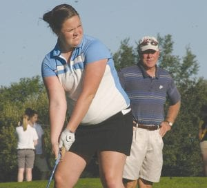 Keri Hart lined up a tee shot in the Lapeer Summer Tuneup.