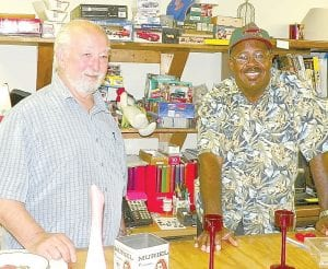 Patriarch Joe Harris (above left), who runs the antiques mall part of the business with Charlie Williams (right), who works in the store and also is a booth owner. At left, Items from estate of well-known toy collector Jiggs Geller are ready to be sold in an upcoming auction. There's parking for at least 500 cars at Harris Brothers, a familyowned business on Van Slyke Road.