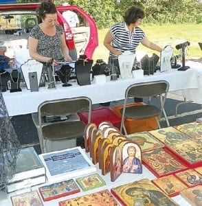 Vendors setting up jewelry and items from the church bookstore to sell at the St. George Orthodox Church Middle Eastern Festival August 26-27.