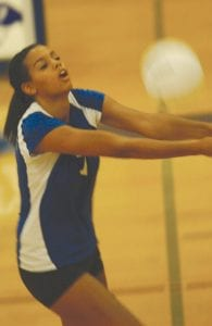 Kamrin Gold makes the set for the Carman-Ainsworth varsity volleyball team during a recent contest.
