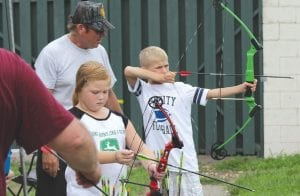 Kids learn archery at JAKES event.