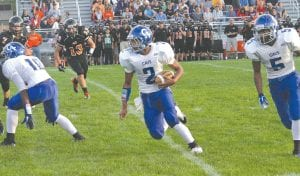 Shane Barron (2) scored two touchdowns and Lorenzo Redmond (5) scored the other for Carman-Ainsworth last Friday at Flushing.