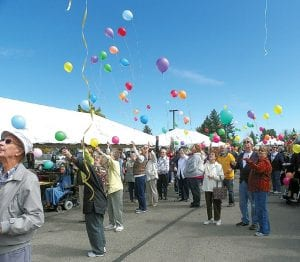 Above: After a countdown from 10 to 1, everyone releases balloons at the time time in this 22-yearannual tradition for the Woodhaven Senior Community Fall Fest.