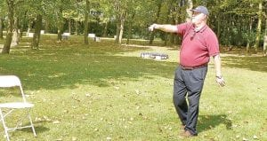 Chris Hamilton, executive director of Old Newsboys, particpates in a football toss, showing off his form from his days playing for the 1967 Purdue Uni