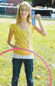 The winner of the hula hoop contest is Kennidy Coburn, 12, (above) a student at Durand Middle School.