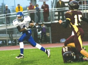 Brandon Walker took this pass reception 47 yards for a touchdown at Davison last Friday.
