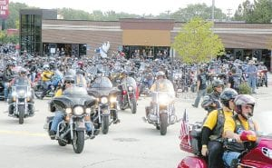 Riders embark on a police escorted run from Vehicle City Harley-Davidson on Miller Road inFlint Township to downtown Flint for the annual Bikes on the Bricks event.